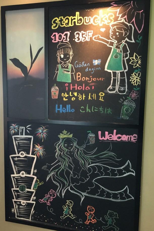 Chalkboard sign for Starbucks 101 in Taipei