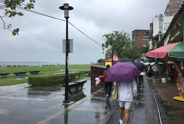 Walking in Tamsui near the water in Taipei