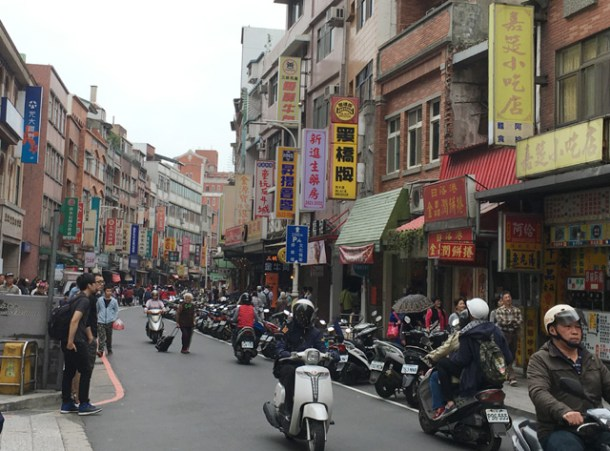 Many motorcycles in the road in Tamsui in Taipei