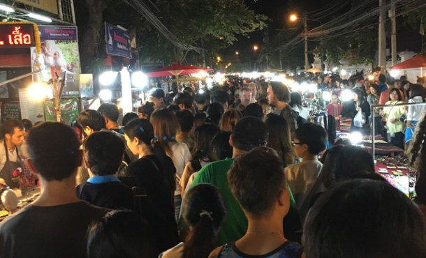 Crowds of people looking at stalls in the street at the Sunday Night Market in Chiang Mai