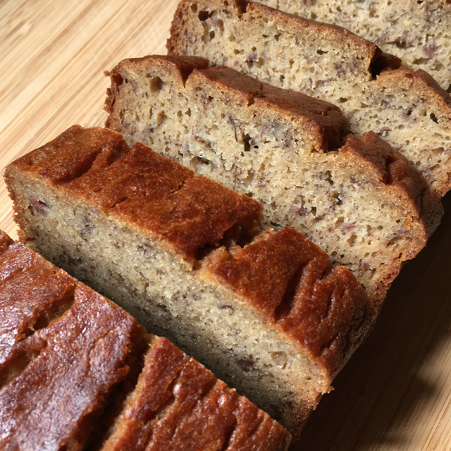 Close-up of thick slices of gluten-free banana bread on a cutting board