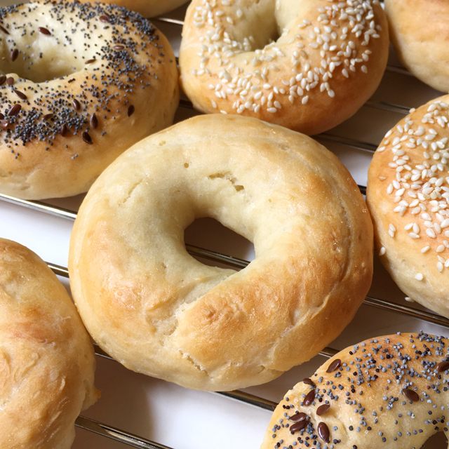 Homemade bagels on a cooling rack