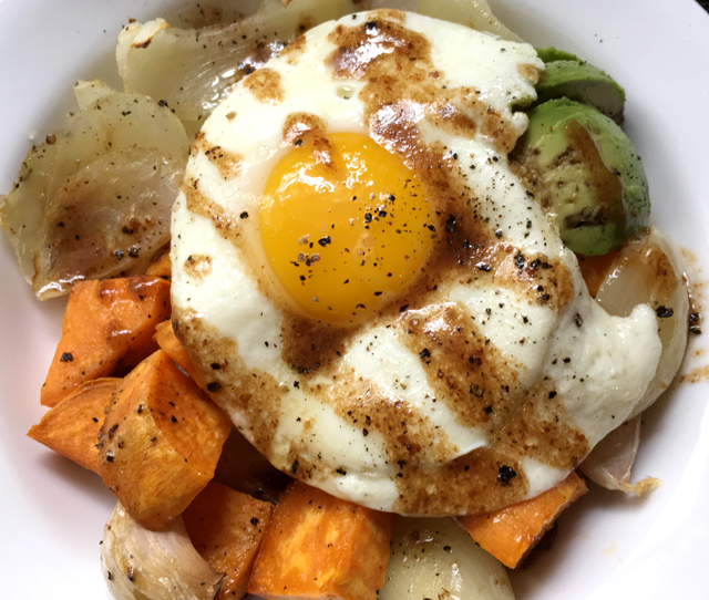 Balsamic vinaigrette drizzled over a fried egg and roasted vegetables