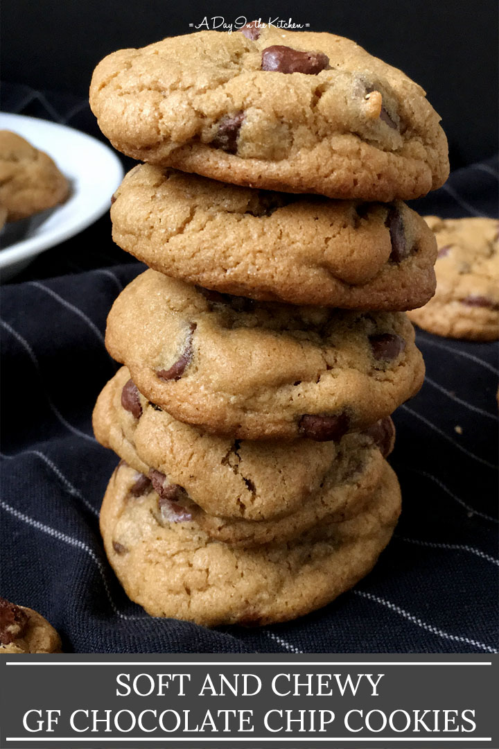 A stack of 5 chocolate chip cookies on a dark blue cloth, the words soft and chewy gf chocolate chip cookies on the bottom