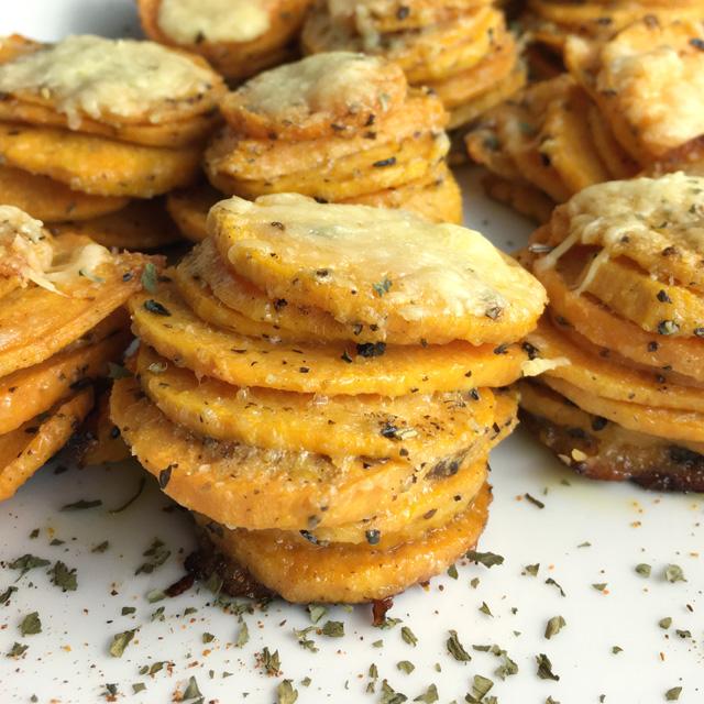 Close-up sweet potato stacks on a white plate