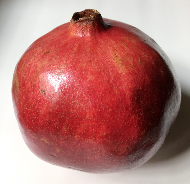 A whole pomegranate for how to open a pomegranate