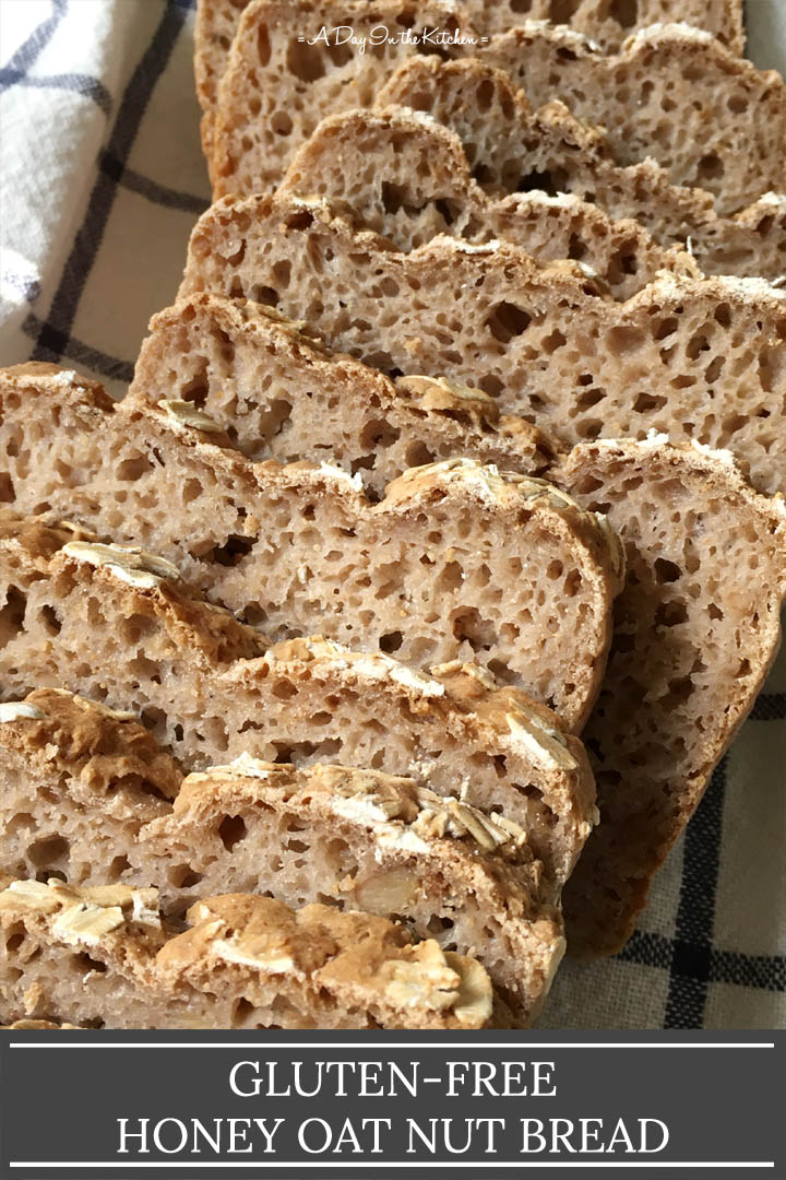 Several slices of brown bread on a white and blue towel, the words gluten-free honey oat nut bread on the bottom