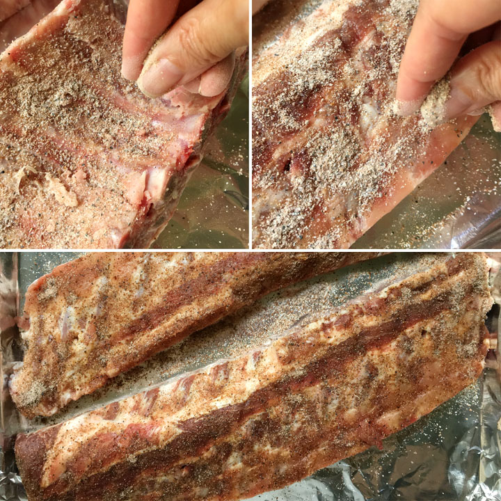 Close-ups of a hand sprinkling seasoning powder on a rack of ribs, the ribs on a foil-lined baking pan