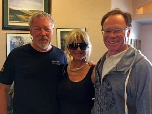 Motorcycle artist A.D. Cook, artist Beti Kristof and Woody, president Buffalo Chip