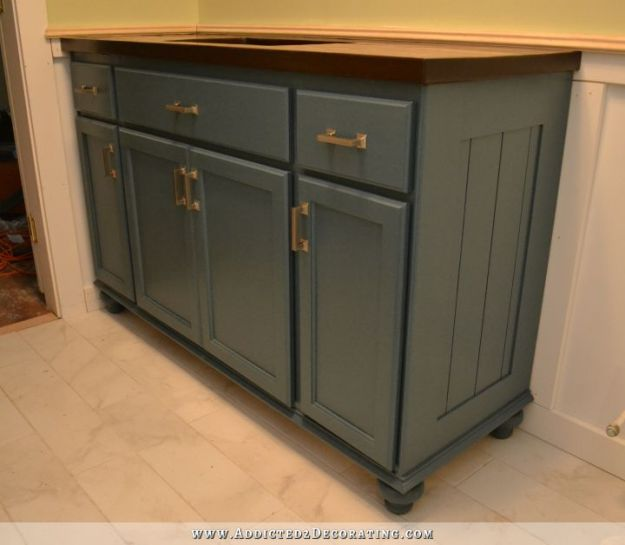 teal furniture-style vanity made from stock cabinets – finished!