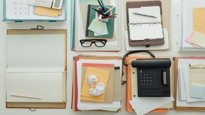 A desk full of paper clutter