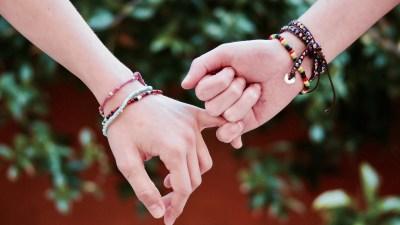 Friends wear lasting friendship bracelets
