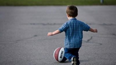 ADHD toddler chasing basketball