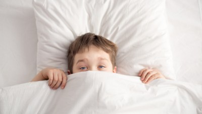 A boy is unable to wake up in the morning, a condition common to children with adhd.