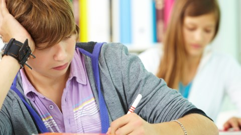 A student reviews notes helping to manage the symptoms of ADHD in high school.