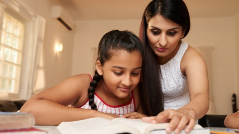 Mom helps her ADHD daughter with homework
