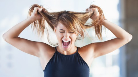 Stressed woman with ADHD pulling hair
