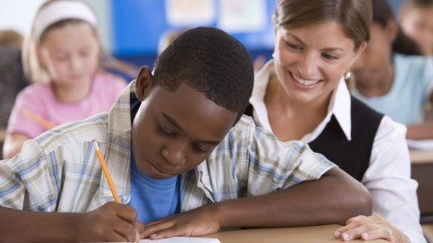 A boy with ADHD using writing strategies in class