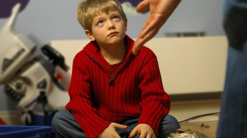 A father disciplines his child using ADHD parenting strategies