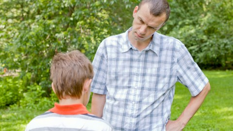 A father disciplines his son with ADHD and conduct disorder.