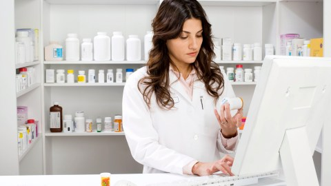 A pharmacist fills a prescription to help manage ADHD emotions.