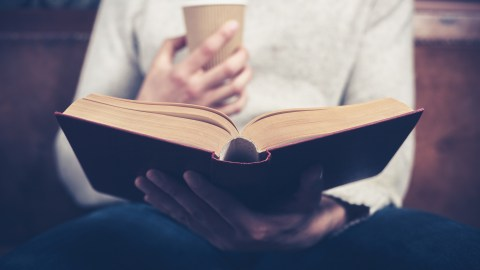 Man reads alone — it's ok to want some solitude.