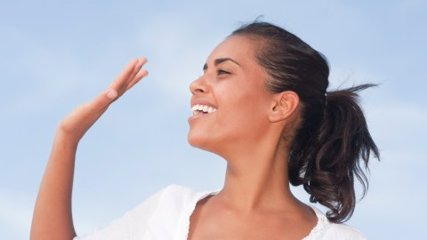 Woman waving away her doubts about herself.