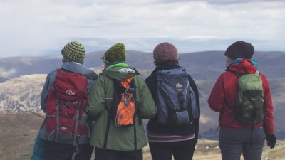 A group of adult friends hiking together