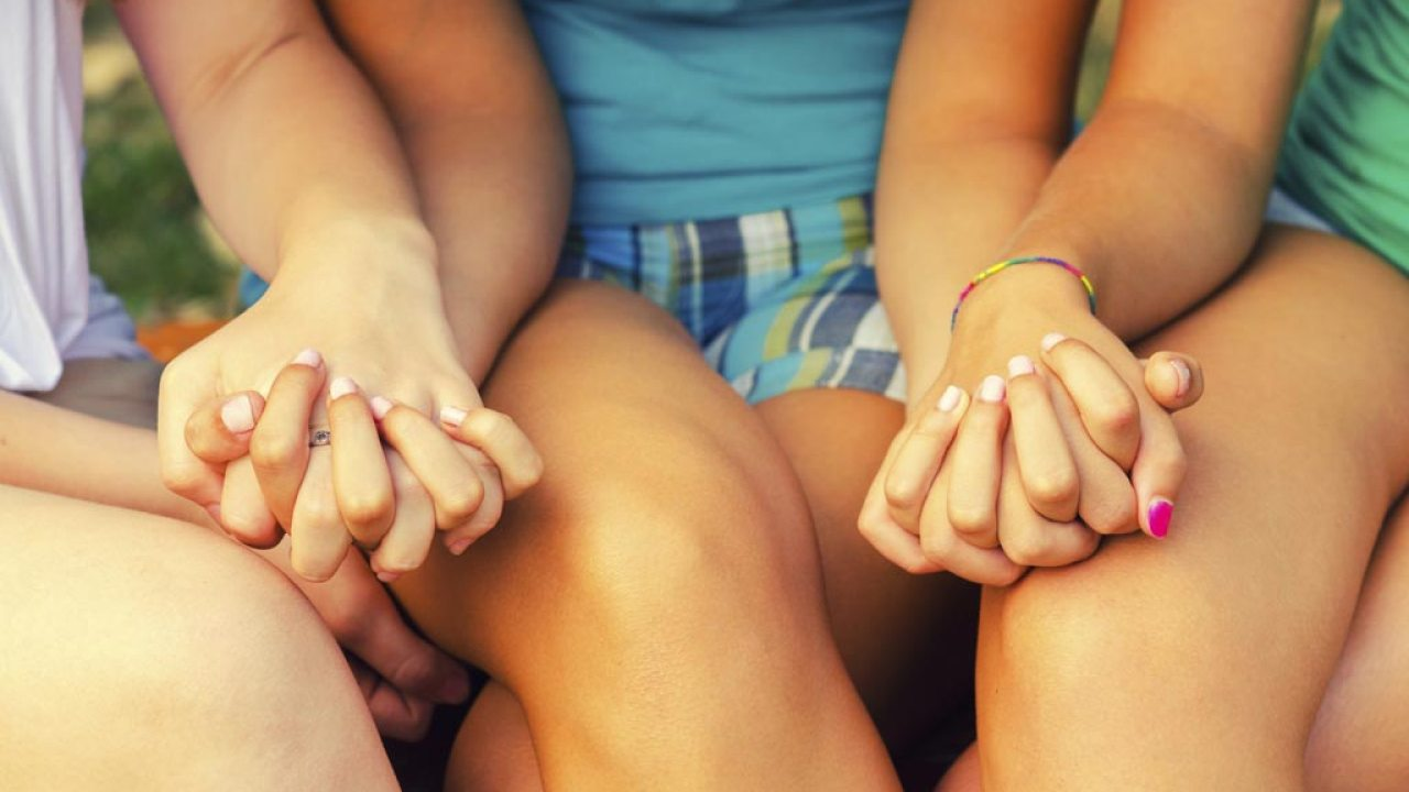 Teen girls with ADHD holding hands outside and forming friendships