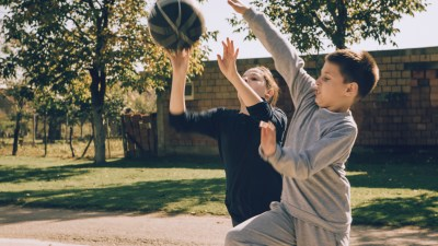 Teen boys with adhd play basketball