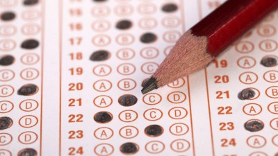 Standardized test with multiple choice bubbles filled in with pencil belonging to ADHD student