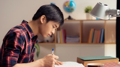 A teen boy with ADHD applying study strategies to prepare for the SAT or ACT test