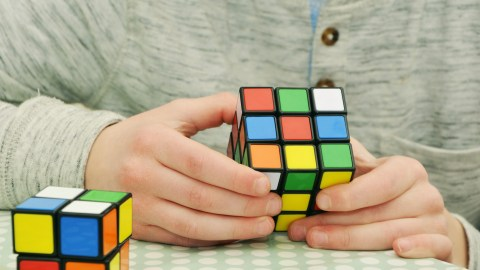 ADHD child doing a rubix cube