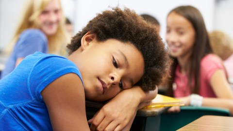 Unhappy Girl Being Bullied In Class