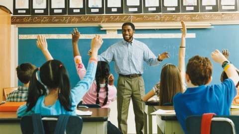 A teacher showing class how to focus on homework