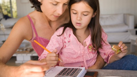 Mother and daughter working on homework and learning how to focus