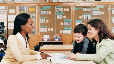 A mom and her son meet proactively with teachers to discuss how the student learns best.