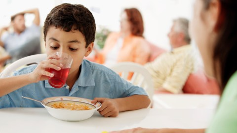 A boy drinks juice with his cereal to boost executive function with sugar