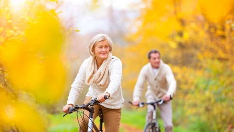 Senior couple bike riding and showing signs of adult ADHD