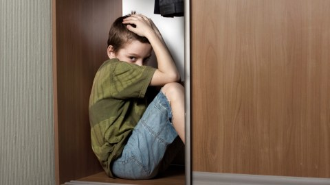 A young boy with ADHD and anxiety hiding in the closet