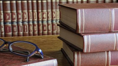 Glasses on law books belonging to ADHD person