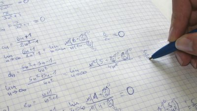 A student with dyscalculia and ADHD learning algebra and completing a math problem