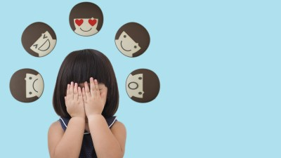 A young girl covering her face after acting out