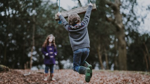 A boy and a girl with ADHD play outside