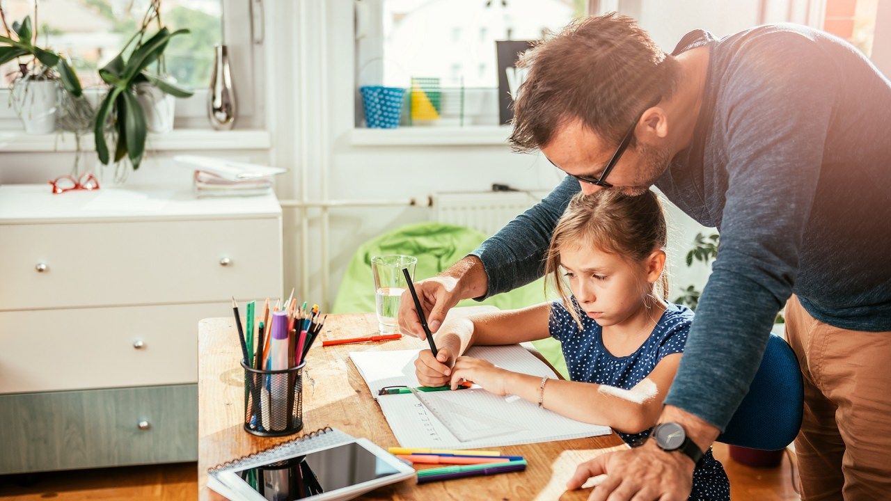 A dad works with his daughter on ADHD motivation techniques.