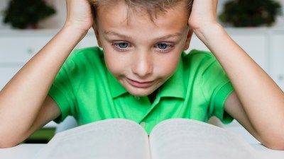 ADHD boy is having reading and learning difficulties