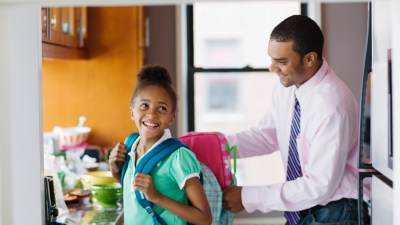 Man Helping Daughter with ADHD with Backpack