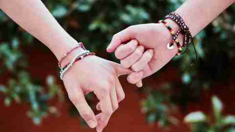 Friends wear lasting friendship bracelets