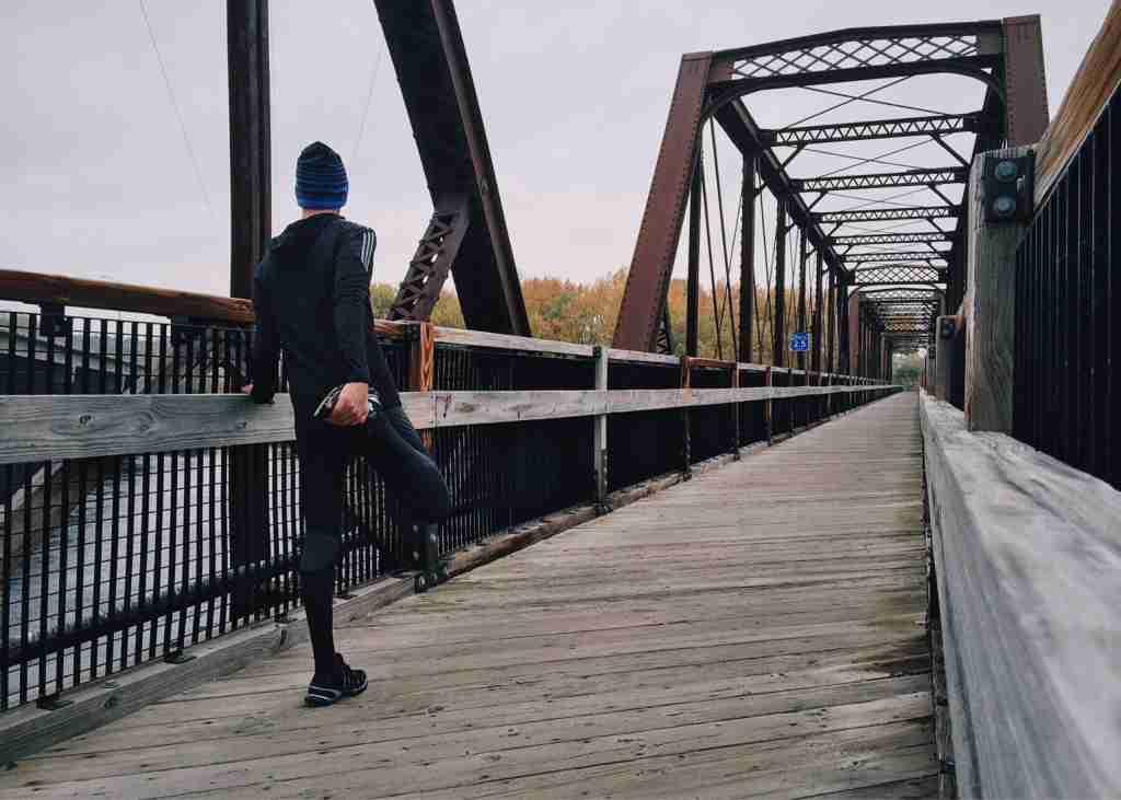 ADHD man stretching before he jogs
