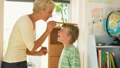 Mom measures height of son who has ADHD and possibly stunted growth
